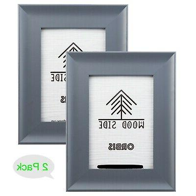grey wooden picture frames with wide molding